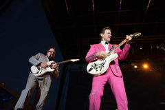 Chris Isaak. LINCOLN, CA - AUGUST 16: Rowland Salley (R) and Chris Isaak perform at Thunder Valley Casino Resort on August 16 in Lincoln, California Royalty Free Stock Photography