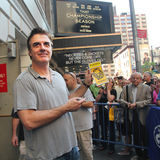 Chris noth on broadway. Chris noth holding the playbill of the lion king that was given to him to sign an autograph.he can't believe it and debating if to sign stock photo