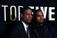 Chris Rock, Kanye West. NEW YORK-DEC 3: Comedian/actor Chris Rock and rapper Kanye West attend the Top Five premiere at the Ziegfeld Theatre on December 3, 2014 Stock Photography