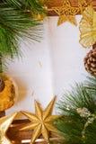 Chrismas装饰和纸页 库存图片