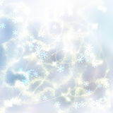 Chrismas background. Chrismas blue festive background with silver beams and sparkles Royalty Free Stock Images