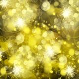 Chrismas background. Shining chrismas background with golden beams and sparkles Royalty Free Stock Images