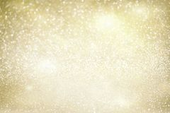 Chrismas background with sparkles. Chrismas festive golden and silver background with lights bokeh Royalty Free Stock Photography