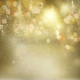 Chrismas background with sparkles. Chrismas dark golden and silver background with bright sparkles and lights Stock Photo
