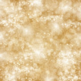 Chrismas  background with sparkles. Chrismas golden background with bright  sparkles and lights Stock Photos