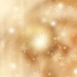 Chrismas  background with sparkles. Chrismas golden background with bright  sparkles and snowflakes Stock Images