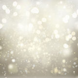 Chrismas background with sparkles. Chrismas silver abstract background with bright sparkles and falling snowflakes Stock Photography