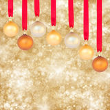 Chrismas balls on golden background Royalty Free Stock Photography