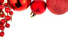 Chrismas baubles and red berries. On white background Stock Photo
