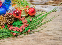 Chrismas baubles and vary of decoration on wood background Stock Photos