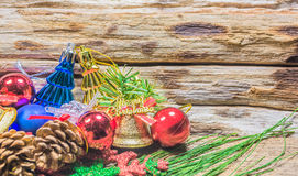 Chrismas baubles and vary of decoration on wood background Royalty Free Stock Photography
