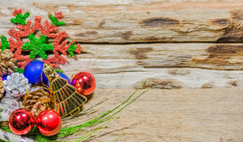 Chrismas baubles and vary of decoration on wood background Royalty Free Stock Image