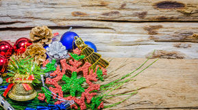 Chrismas baubles and vary of decoration on wood background Stock Photo