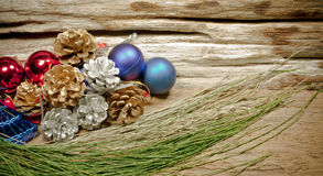 Chrismas baubles and vary of decoration on wood background Royalty Free Stock Photos