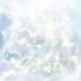 Chrismas blue background. Chrismas light blue festive background with  beams and sparkles Stock Photos