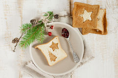 Chrismas breakfast. Spoon berry jam and slice toast bread. Stock Photos
