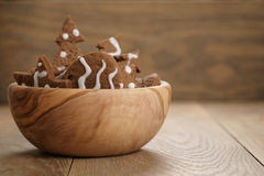 Chrismas chocolate cookies in wooden bowl on oak table with copy space Royalty Free Stock Photos