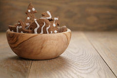Chrismas chocolate cookies in wooden bowl on oak table with copy space Royalty Free Stock Image