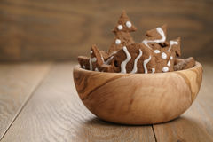 Chrismas chocolate cookies in wooden bowl on oak table with copy space Royalty Free Stock Images