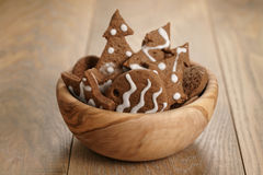 Chrismas chocolate cookies in wooden bowl on oak table Royalty Free Stock Photos