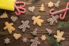 Chrismas cookies, candy canes on wooden background. Holiday mood. Top view. Stock Photos