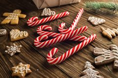 Chrismas cookies, candy canes on wooden background. Holiday mood. Top view. Royalty Free Stock Images