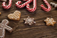 Chrismas cookies, candy canes on wooden background. Holiday mood. Top view. Royalty Free Stock Photography