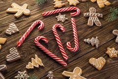 Chrismas cookies, candy canes on wooden background. Holiday mood. Top view. Royalty Free Stock Photo