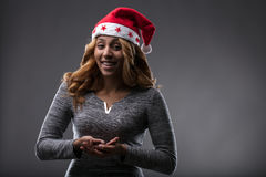 Chrismas costume on a girl holding a placeholder front perspect Royalty Free Stock Image