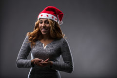Chrismas costume on a girl holding a placeholder front perspect Stock Photo