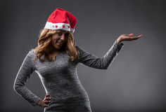Chrismas costume on a girl showing a placeholder for a product Royalty Free Stock Images