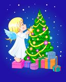 Chrismas cute angel. Angel putting star on Christmas tree Stock Photo