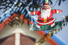 Chrismas decoration with santa claus hanging. On tree Royalty Free Stock Photo