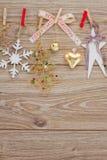 Chrismas decorations hanging on clotheline Stock Image
