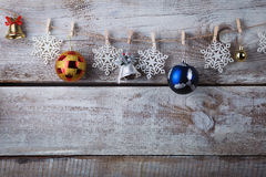 Chrismas decorations hanging on rope on wooden background Royalty Free Stock Photography