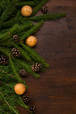 Chrismas decorations, larch and fir branches and pine cones on t. Flat lay border.  fir branches and pine cones. emty space for text Royalty Free Stock Images