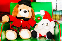 Chrismas dog doll and Smurf doll Royalty Free Stock Photography