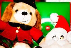 Chrismas dog doll and Smurf doll Stock Photos