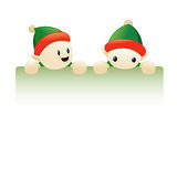 Chrismas elves holding blank sign Stock Image