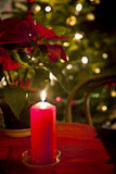 Chrismas eve at home, red candle lit Royalty Free Stock Image