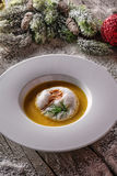 Chrismas fish soup in white plate with christmas decorations, modern gastronomy stock images