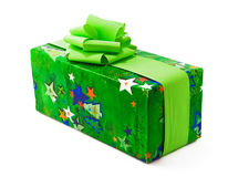 Chrismas gift wrapped in green paper with bows Stock Image