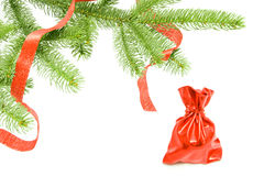 Chrismas gifts under the conferous tree. Red sack with the christmas gifts under the coniferous tree Stock Photo