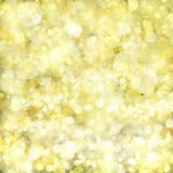 Chrismas golden background. With bright beams and sparkles Stock Images