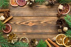 Chrismas holiday brown background. Dried sicilian oranges with cinnamon sticks, anise and golden cones. Copy space. Chrismas holiday brown background. Dried royalty free stock photo