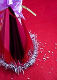 Chrismas or new year cap and snow. Chrismas or new year snow cap on red cloth Stock Photography