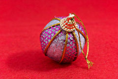 Chrismas or new year tree decoration. On red cloth Royalty Free Stock Photo