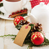 Chrismas themed tea with gifts and decorations Stock Photos