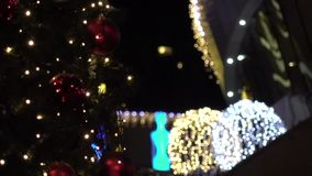 Chrismas tree on city street out of focus. stock video