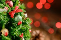 Chrismas tree with gift and red light bokeh= Stock Photo